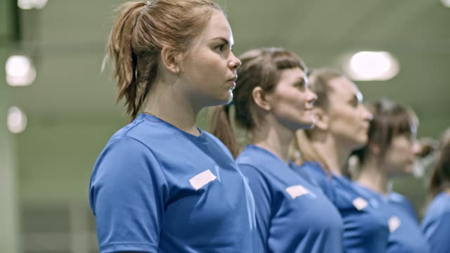 Women only soccer team standing in row