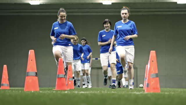 Women only soccer team warming up before game