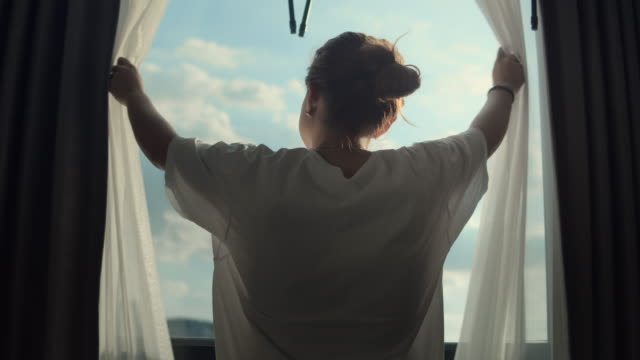 women open and close the curtains in the morning,slow motion - curtain stock videos & royalty-free footage