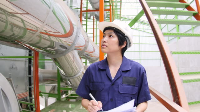 4k : women operator at industrail factory - quality control stock videos and b-roll footage