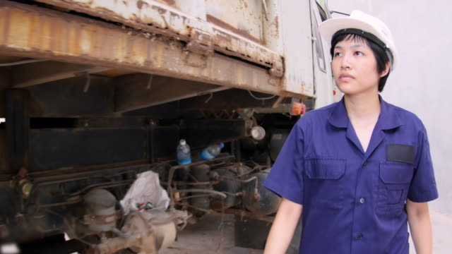 4k : women operator inspect a truck - looking over stock videos and b-roll footage