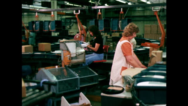 women pack vinyl records on production line; 1973 - production line worker stock videos & royalty-free footage