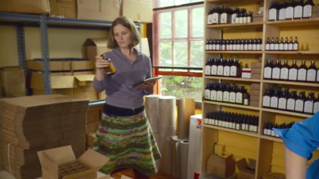 ms women packing bottles into boxes in shop / burlington, vermont, usa. - burlington vermont stock videos & royalty-free footage