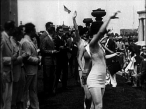 B/W 1921 women parading about in outdoor swimsuit competition / documentary