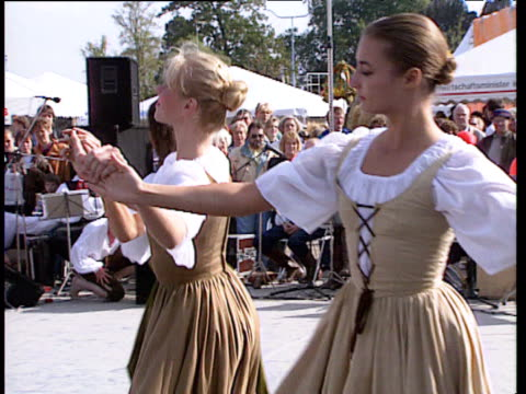 women perform dance in traditional costume at festival germany - traditional ceremony stock videos & royalty-free footage