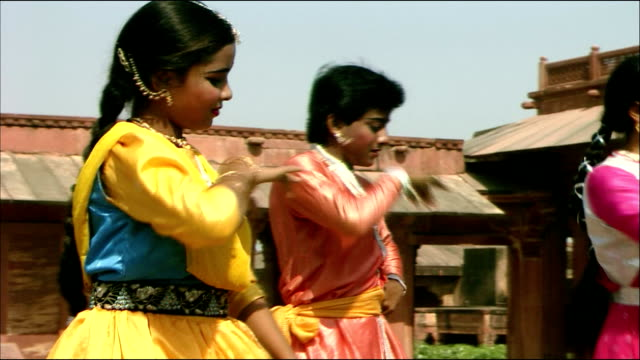 Women perform dance routine at Agra Fort, Agra
