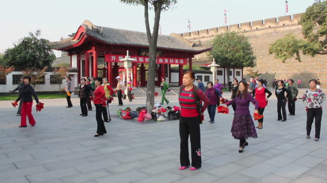 WS Women performing dance in city wall Park/xian,shaanxi,China
