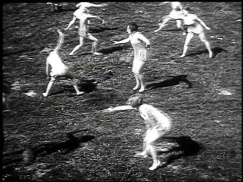 stockvideo's en b-roll-footage met 1930 montage women performing gymnastics swinging ball exercises, may 17, 1930 / hanover, germany  - gymnastiek