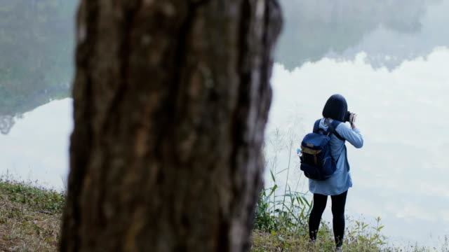 women photographer taking photograph in beautiful nature - mae hong son province stock videos and b-roll footage