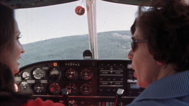 women pilots fly a single-engine airplane. - pilot stock videos & royalty-free footage