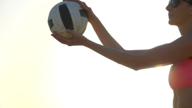 Women players play beach volleyball and a player serves the ball. - Slow Motion - filmed at 180 fps