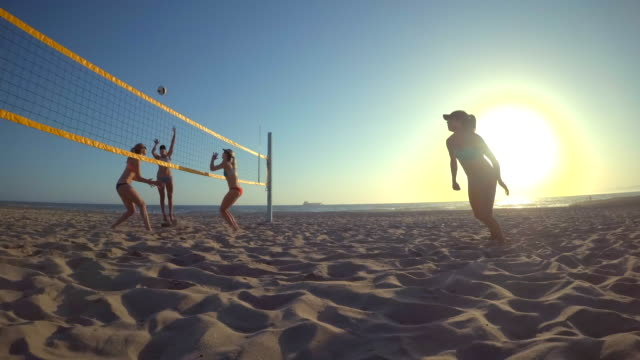 pov of women players playing beach volleyball and a girl hitting the ball. - sun visor stock videos & royalty-free footage