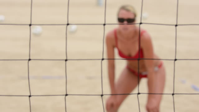 cu r/f women playing beach volleyball through net / redondo beach, california, united states - volleyballnetz stock-videos und b-roll-filmmaterial