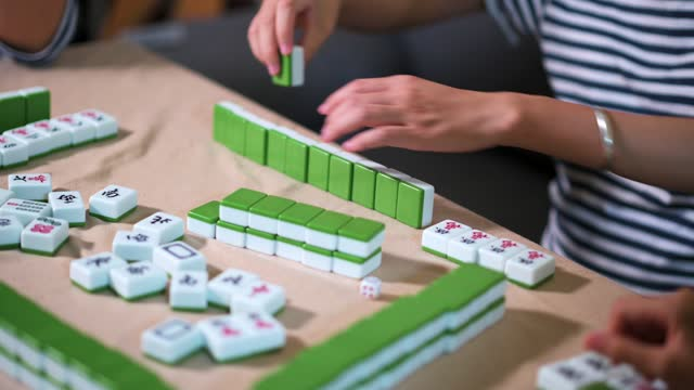 women playing chinese board game mahjong or majiang at home - chinese ethnicity stock videos & royalty-free footage