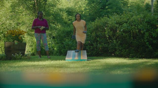LS of women playing cornhole