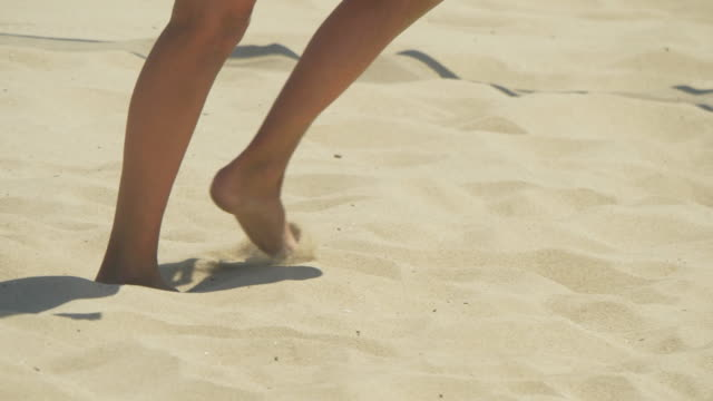 women playing pro beach volleyball in the sand. - slow motion - swimwear点の映像素材/bロール