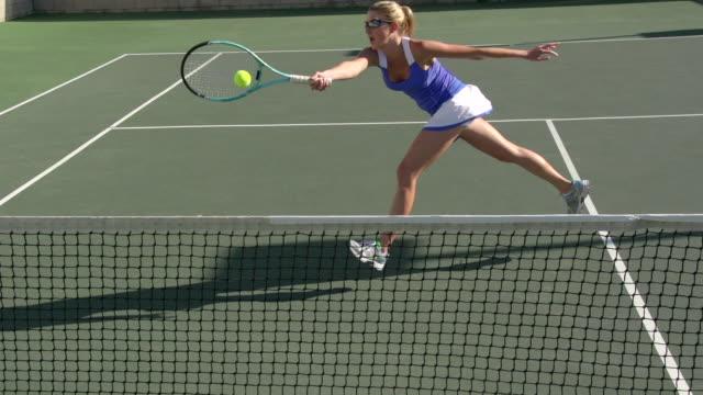women playing tennis. - slow motion - tennis racket stock videos & royalty-free footage