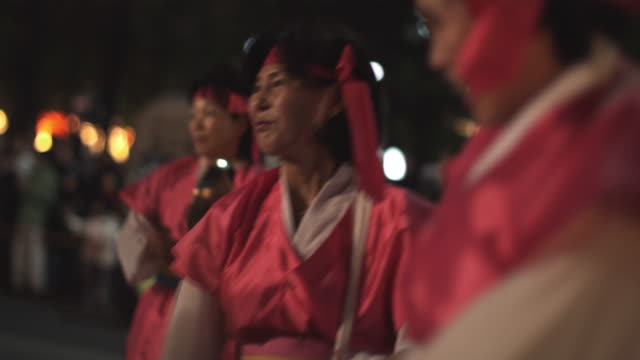 cu selective focus pan women playing traditional drums at buddha's day lantern parade, night, seoul, south korea - korea stock videos & royalty-free footage