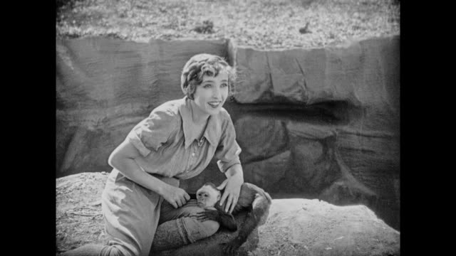 1925 women plays happily with tame monkey - tame stock videos & royalty-free footage