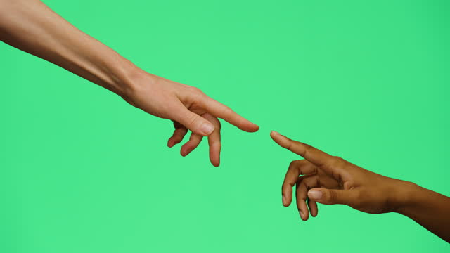 cu women pointing fingers together on green screen - human finger stock videos & royalty-free footage