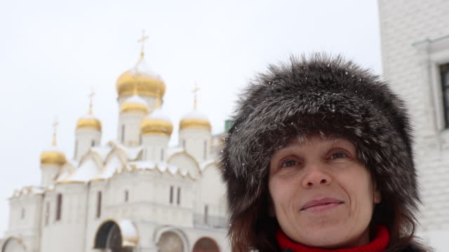 women portrait in front of a church in the Kremlin