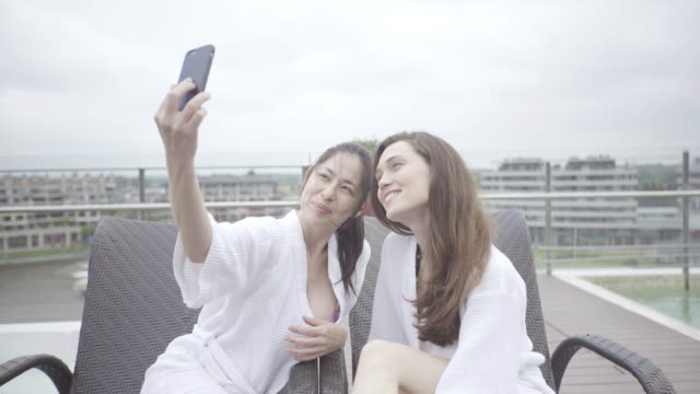 women posing for selfie at luxury spa - adirondack chair stock videos & royalty-free footage
