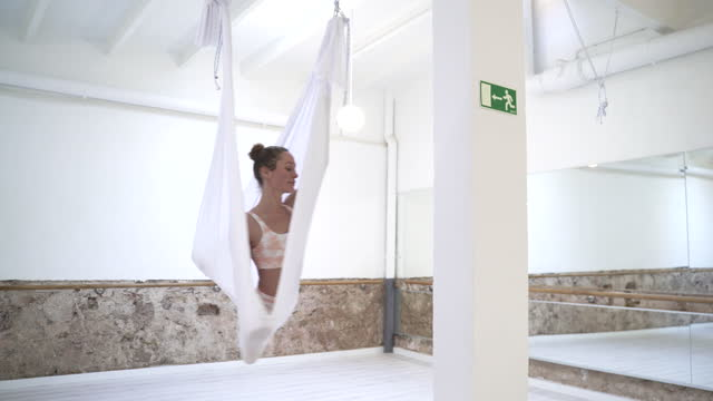 women practicing aerial yoga. - barre stock videos & royalty-free footage