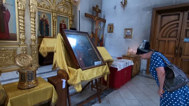 women praying inside st. george's cathedral in vladikavkaz the capital city of the republic of north ossetia-alania in the north caucasian federal... - eddie gerald stock videos & royalty-free footage