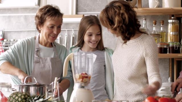 women preparing smoothie in the kitchen - abundance stock videos & royalty-free footage