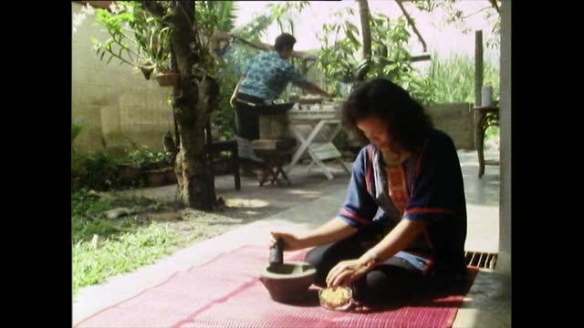 women prepping thai food while sitting on floor; 1989 - thai food stock videos & royalty-free footage