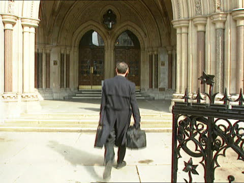 women priests; b) england: london: high court: ext rev paul williamson along towards and displays document to camera tx 16.4.94/13.00 - itv news at one stock videos & royalty-free footage