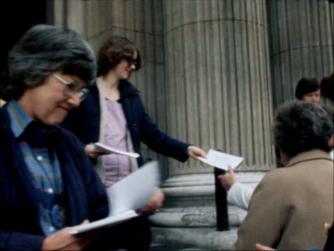 london st pauls cathedral ext london tilt exterior st pauls ms women pan more as they hand out leaflets ms more ditto ms 2 hold slogan 'ordain women'... - priest stock videos & royalty-free footage