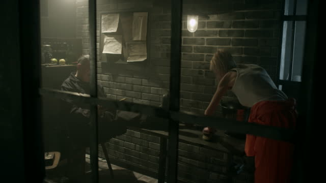 women prisoner cleaning table in jail thru window - prison guard stock videos & royalty-free footage