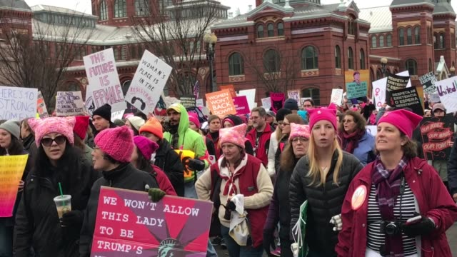 women protest against president trump protesters signs banners flags women marching chanting slogans abortion rights reproductive rights hillary... - sprechgesang stock-videos und b-roll-filmmaterial