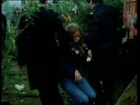 women protesters being carried or dragged away by police one being pulled from the cab of bulldozer greenham common protests 27 may 82 - newbury england stock videos & royalty-free footage