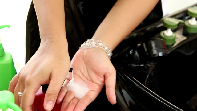women pump shampoo on hand - shampoo stock videos & royalty-free footage