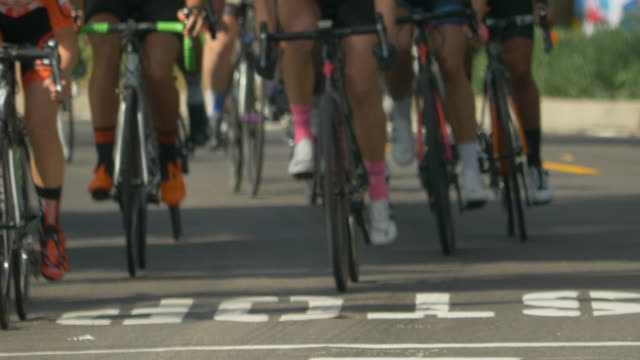 women racing in a road bike bicycle race. - motorcycle biker stock videos & royalty-free footage