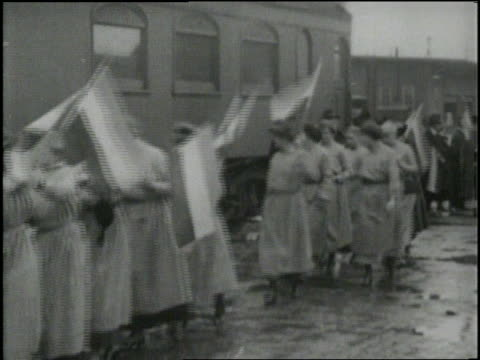 Women raise flags and banners during a Women's Rights demonstration
