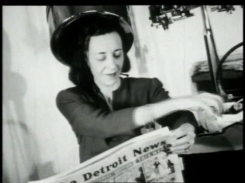 1948 montage women reading newspaper / united states - beauty salon stock videos and b-roll footage