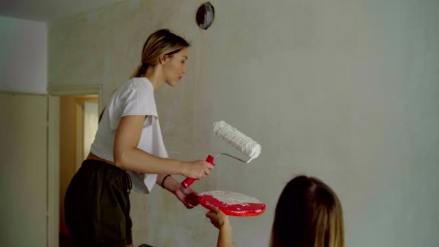 Women redecorating a place to live