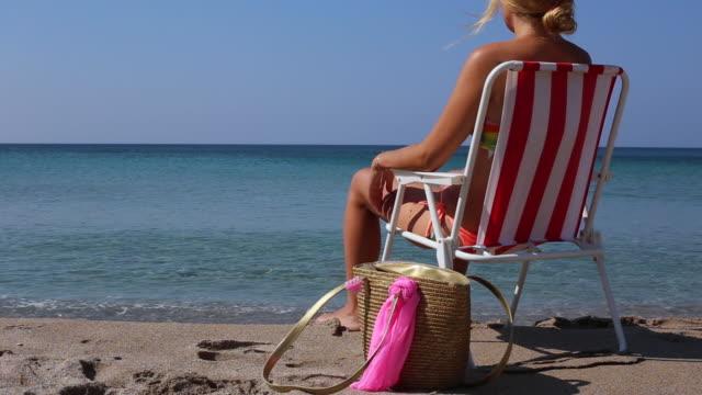 women  relax on beach look sea - byakkaya stock videos and b-roll footage