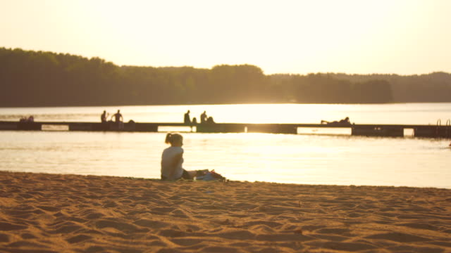 women relax on sunset beach - poland stock videos and b-roll footage