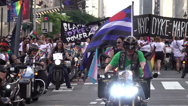 women ride motorcycles with a banner in the background lead the 29th annual dyke march celebrating lgbtq pride on june 26 in new york city. the... - azul stock videos & royalty-free footage