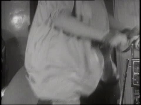 women ride on vibrating exercise machines. - trainingsmaschine stock-videos und b-roll-filmmaterial