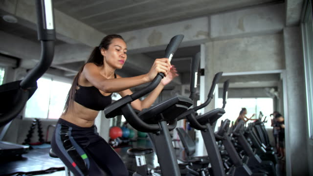 women riding exercise bikes in gym - exercise bike stock videos & royalty-free footage