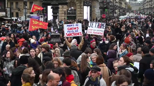 stockvideo's en b-roll-footage met women rights activists hold placards with purple signs adopted by the feminist movement 'nous toutes' as they march during a rally against femicide... - agressie