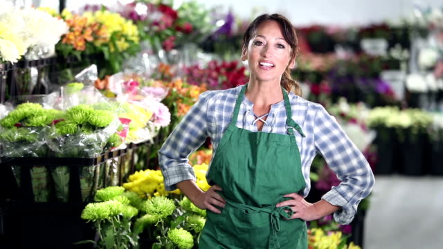 women running a flower shop - hand on hip stock videos & royalty-free footage