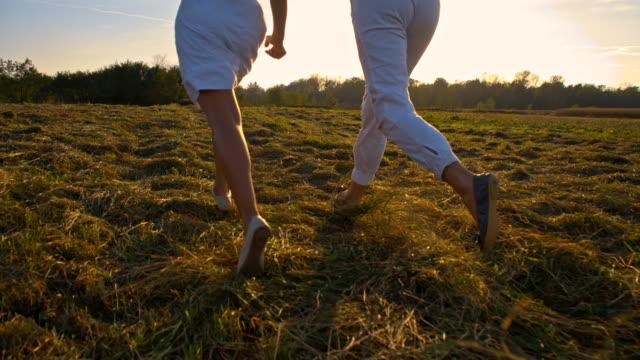 SLO MO Women Running In The Grass