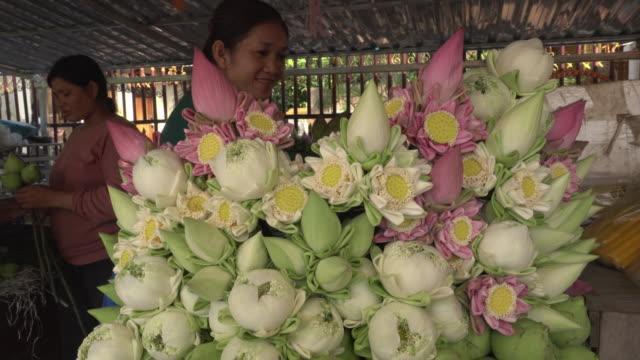 Women selling lotus flower for temple offerings