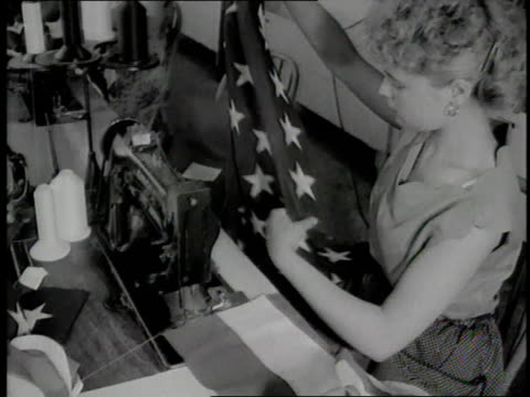 women sew american flags in a factory - 1950 1959 stock videos & royalty-free footage